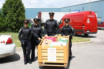 Students gather 3066lbs of food for Cram-A-Cruiser City Challenge