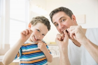 When should I start flossing my children's teeth?