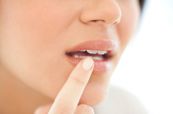 Should I reschedule my dental appointment if I have a cold sore?