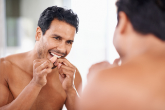 What are the benefits of flossing?
