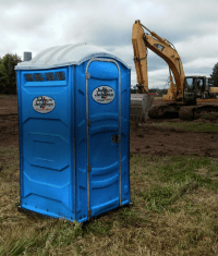 Backhoe hits worker exiting portable toilet