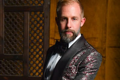 James Temple looks stunning in a King & Bay smoking jacket at the MAD HOT BALLET: Desert Dream Gala