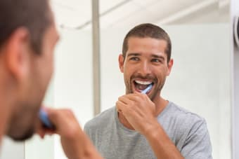 How many times per day should I brush my teeth?