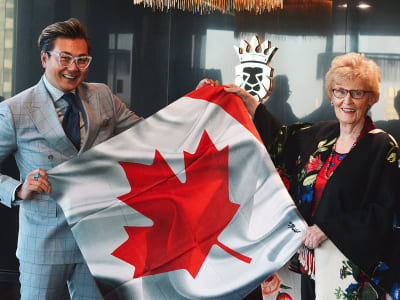Former PEI Premier Catherine Callbeck receives a gift of custom Italian silk scarf from King & Bay
