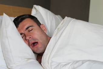 What is the difference between snoring and having sleep apnea?