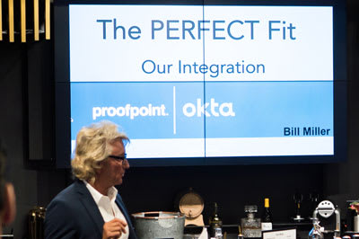 Software companies Okta and Proofpoint team up for a shared private event in the King & Bay lounge