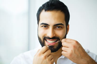 I brush regularly, why should I bother to floss?