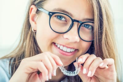 How much do Invisalign clear aligners cost compared to braces?