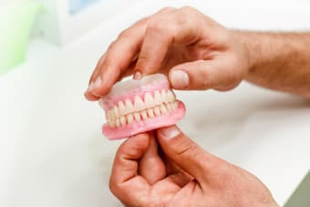 What are dentures made of?