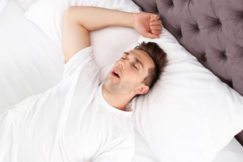 What is the difference between snoring and sleep apnea?